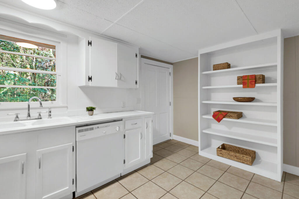 7390 New Era Road view of kitchen sink dishwasher and pantry shelves