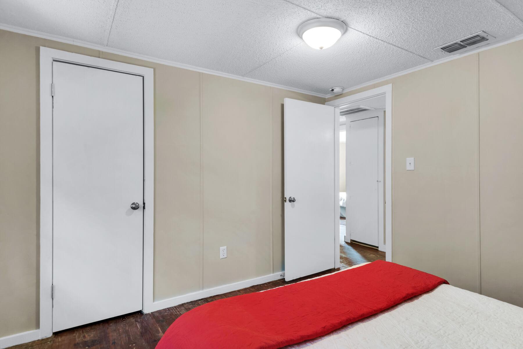 7390 New Era Road northeast bedroom with hall door open